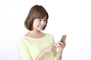女性 携帯電話