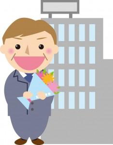 花束を持ったスーツ姿の男性