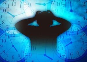 時計 頭を抱える シルエット