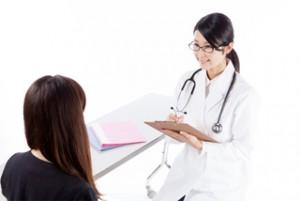 女医 女性の患者 診察