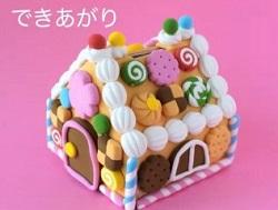 牛乳パックで作ったお菓子の家の貯金箱