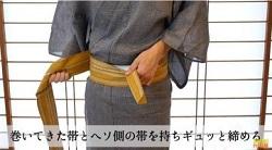 締める 帯